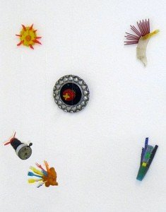 Hubi W. Jäger, Asphaltbluimen, since 1999, Berlin, collage, plastic, metal, textiles etc. 30cm x 15-25cm Recycling
