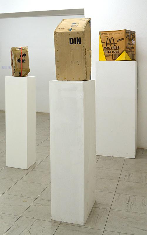 """Katrin Kinsler """"ISO, DIN und MacFries (aus der Serie Antiglobalisierungskartons)"""" 2004 und 2005 Horb, Deutschland Skulptur / Objekt Redesign / Kartonage verschiedene Größen"""